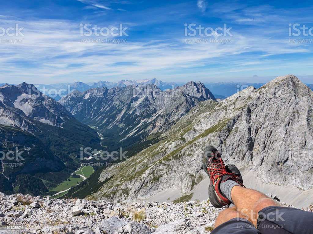 Sitting on top of a mountain stock photo
