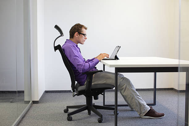 Sitting posture at tablet stock photo