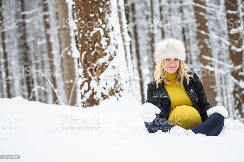 Sitting pregnant woman royalty-free stock photo