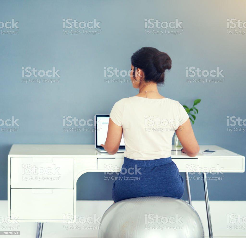Sitting pretty at work stock photo