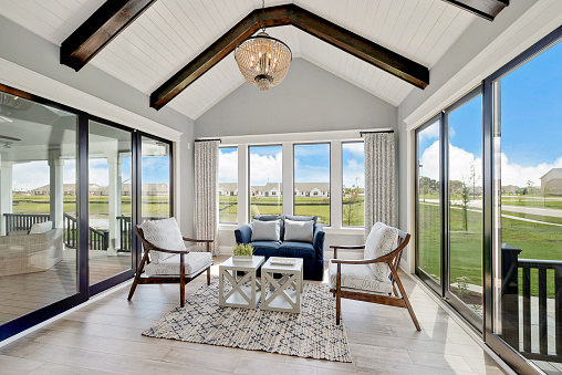 Sitting room surrounded by windows on all sides