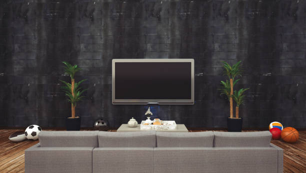 Sitting sofa and watching television tv stock photo