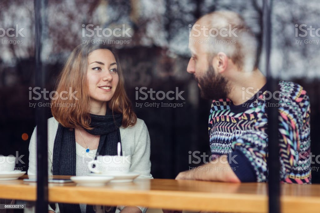 Sitting together for a cup of coffee stock photo