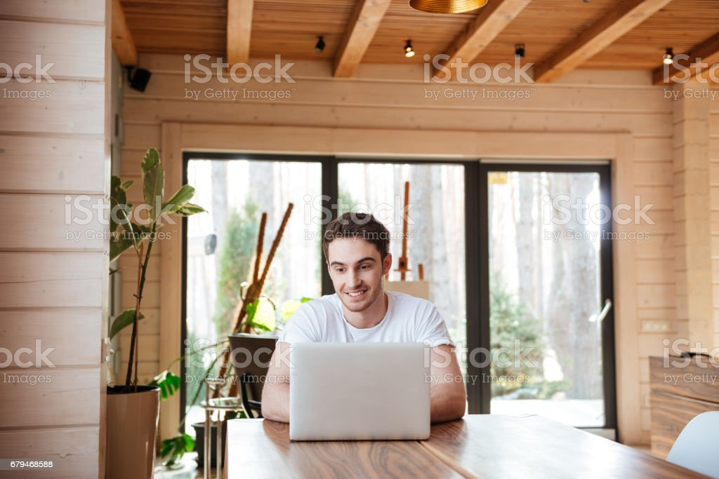 sitting with laptop in living room royalty-free stock photo