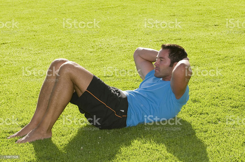 sit-ups in the grass royalty-free stock photo