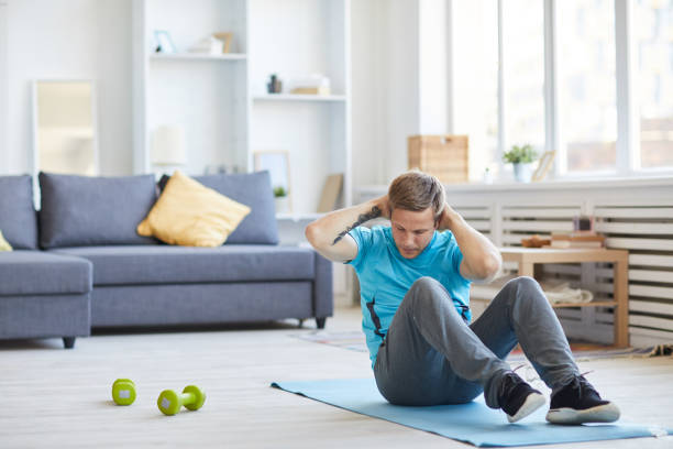sit-ups - shironosov stock pictures, royalty-free photos & images