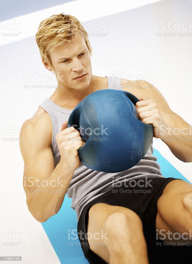 Sit-ups with a medicine ball royalty-free stock photo