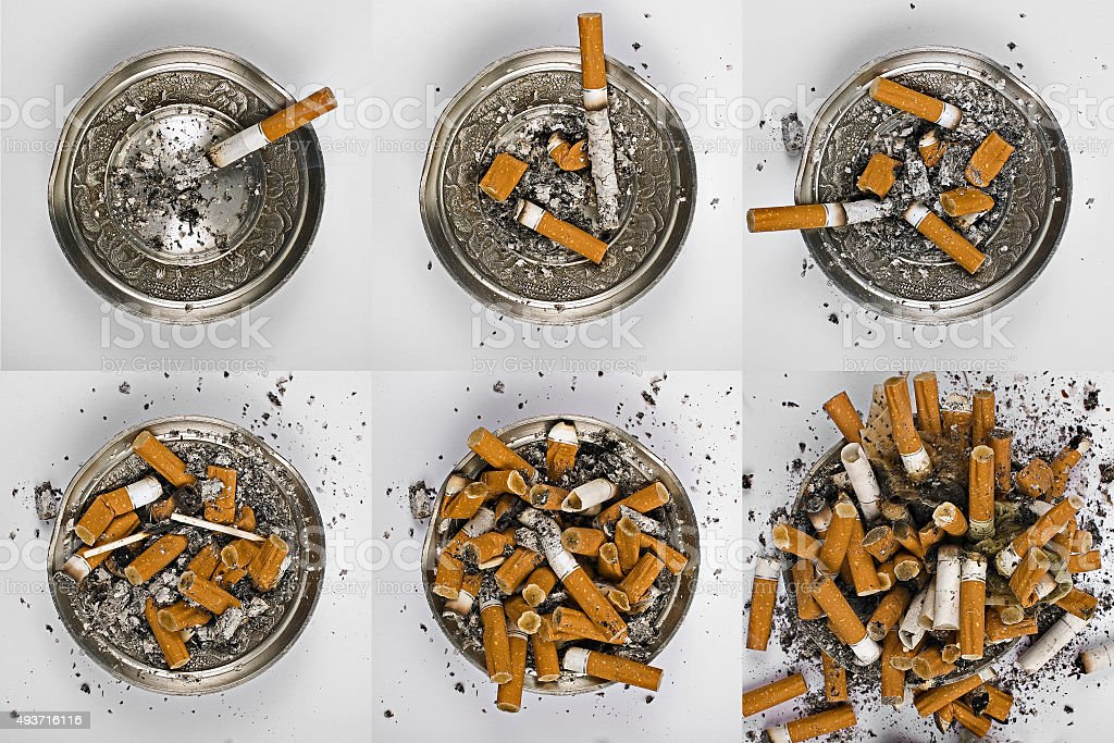 Six ashtray with cigarette butts stock photo