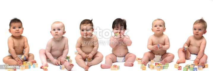 istock Six babies sitting in a row 173865225
