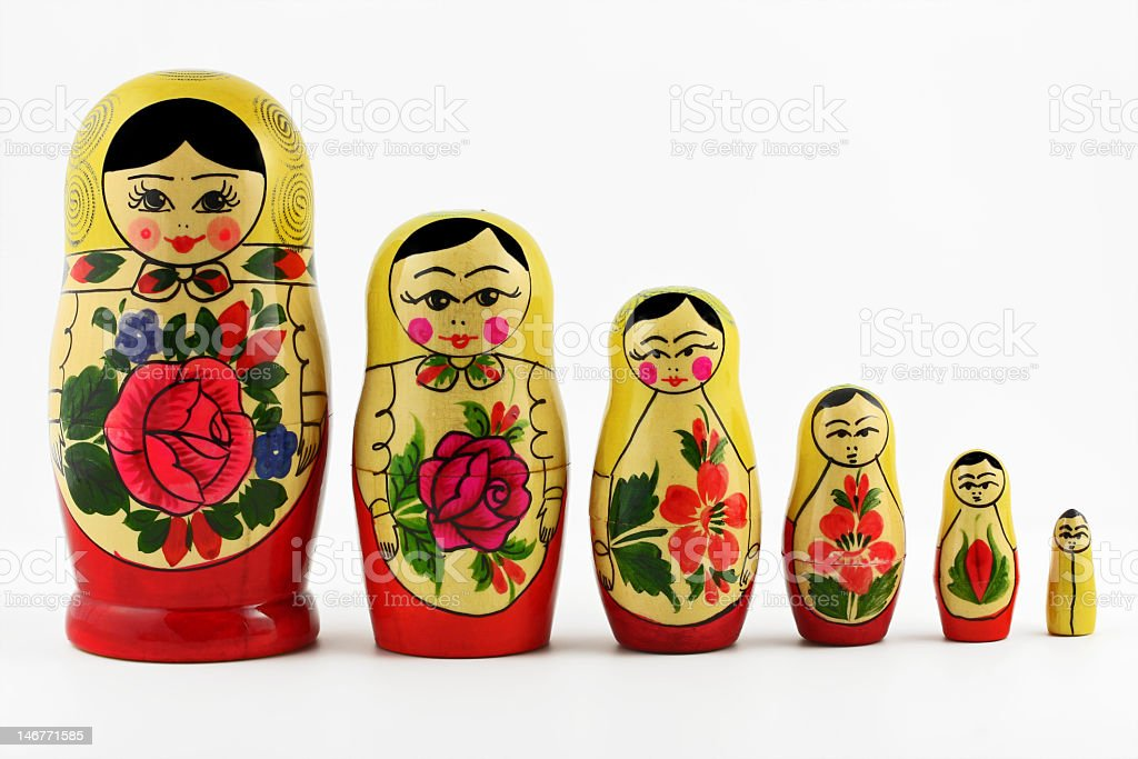 Six babushka dolls on a white background stock photo