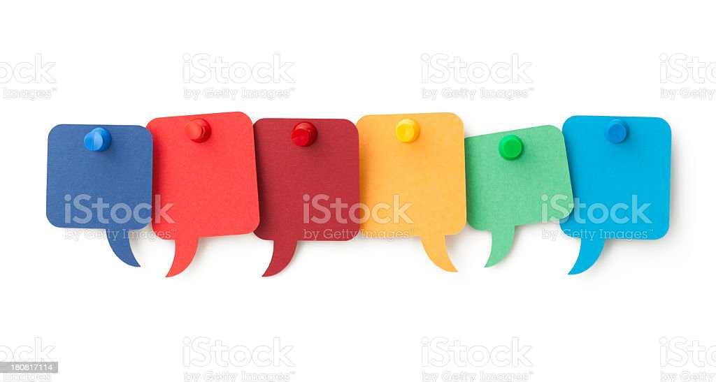 Six blank colourful speech bubbles pinned to a white surface stock photo
