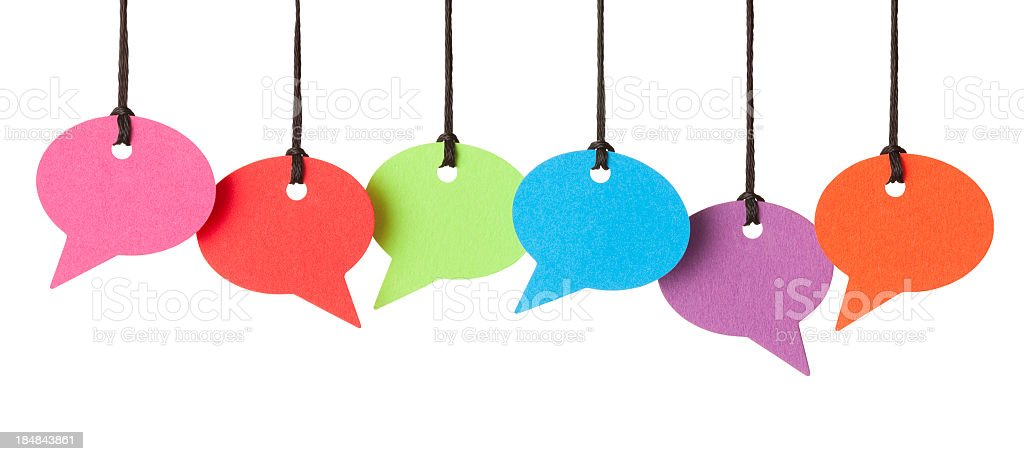Six blank speech bubbles hanging from thread stock photo