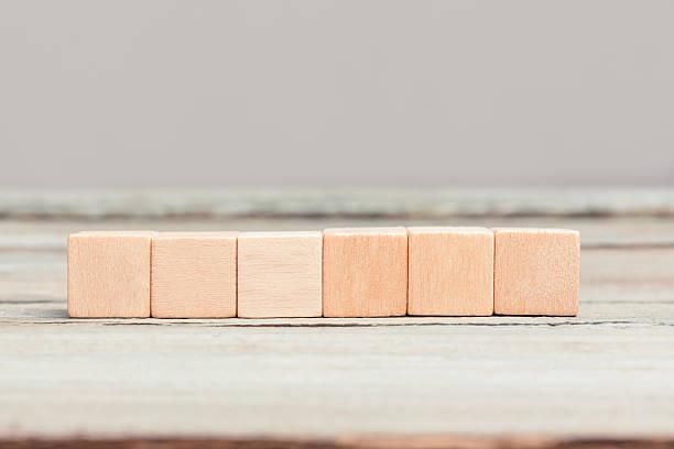 Six blank wood cubes stock photo
