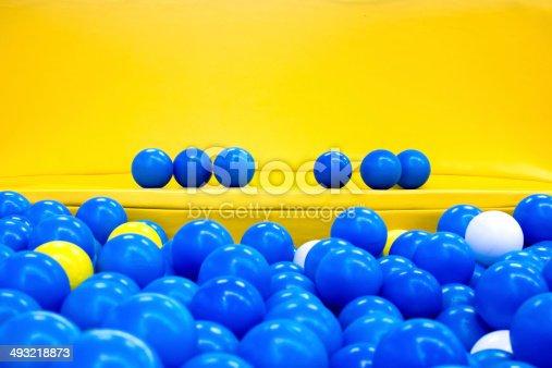 544818734 istock photo six blue balls on the yellow bench 493218873