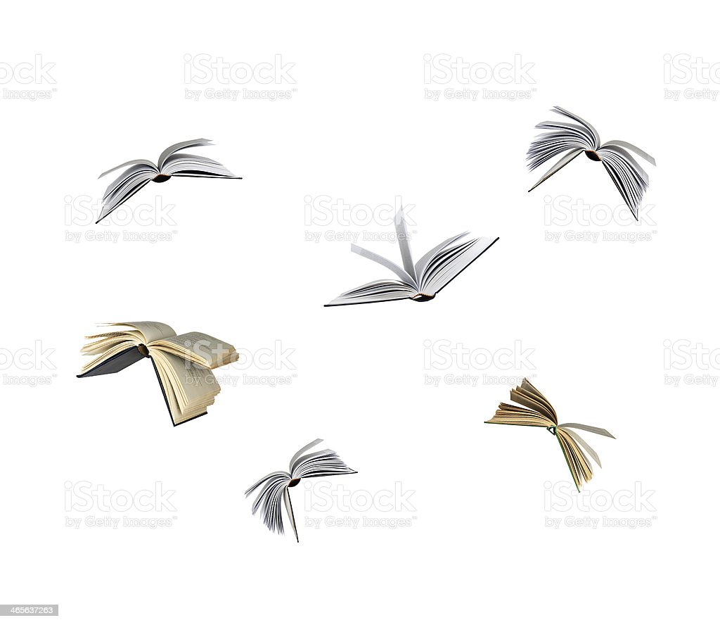 Six books open and flying in the air stock photo