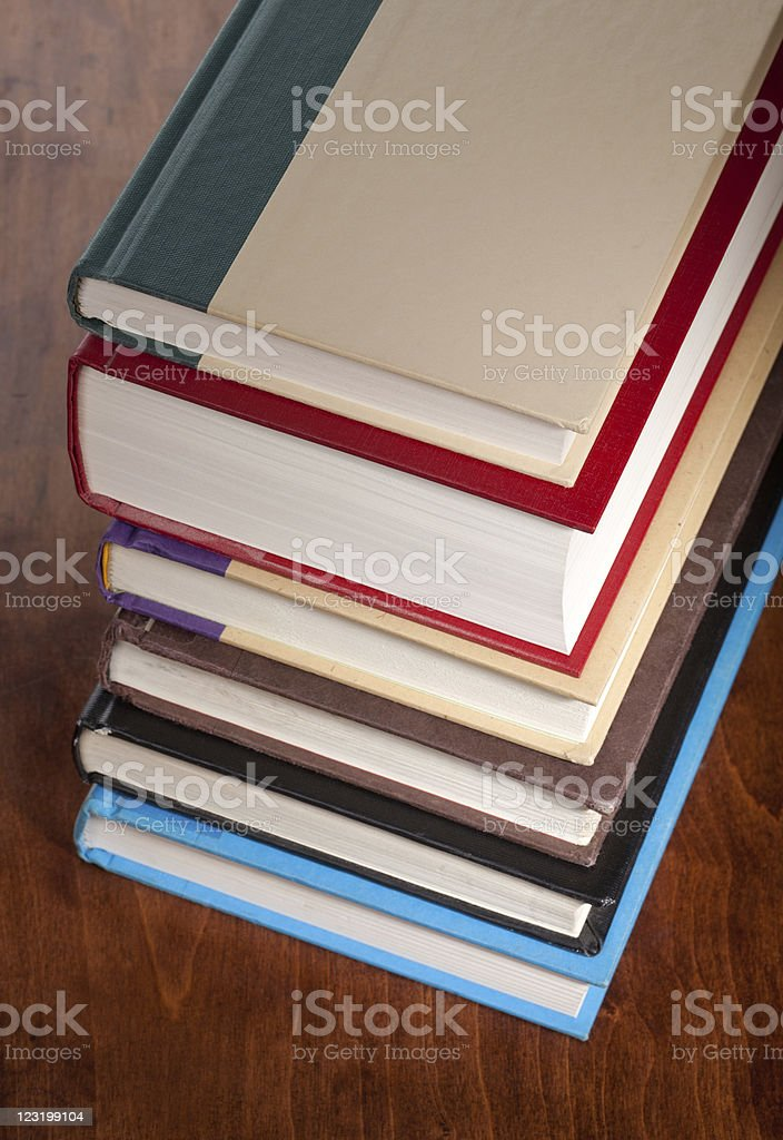 Six books stacked neatly on a table royalty-free stock photo