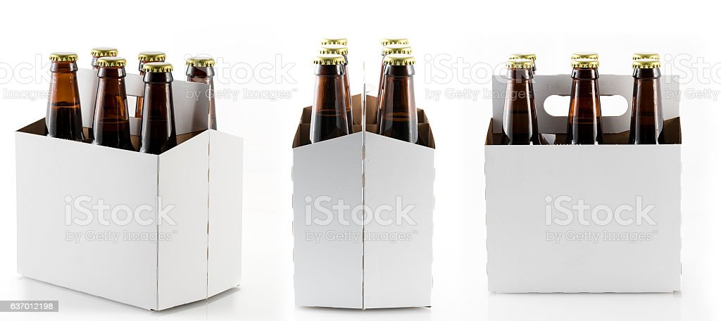 Six bottles of beer in cardboard carrier stock photo