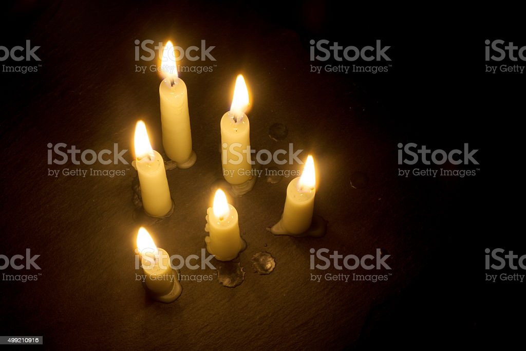 six burning candles on black, view from above, copy space stock photo
