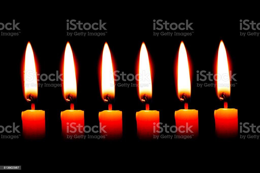 six Candle on black background stock photo