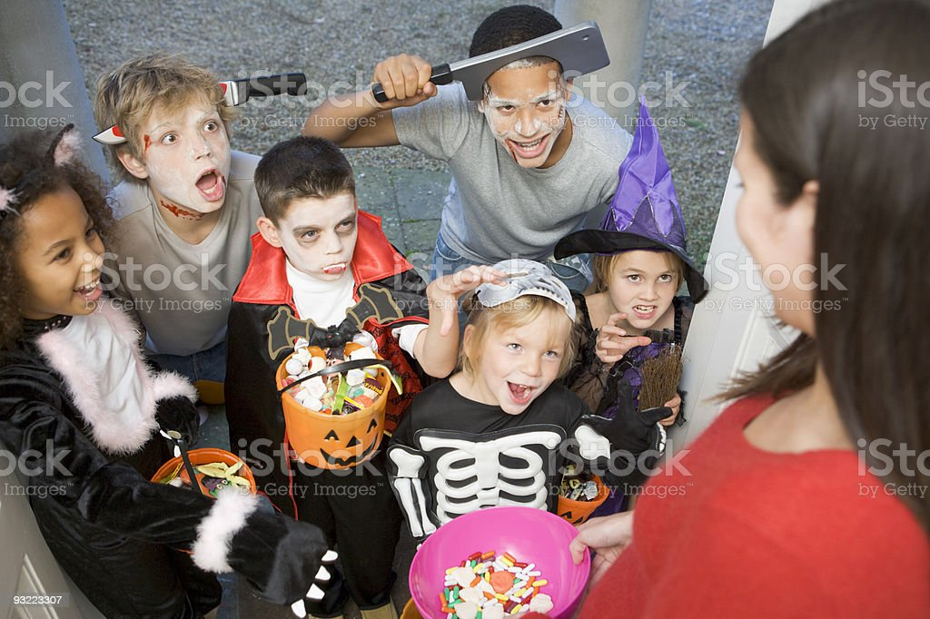 Six children trick or treating on Halloween stock photo