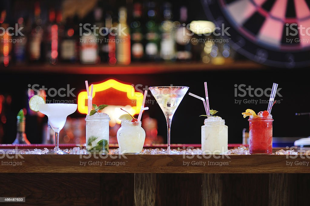 Six cocktails on a bar stock photo