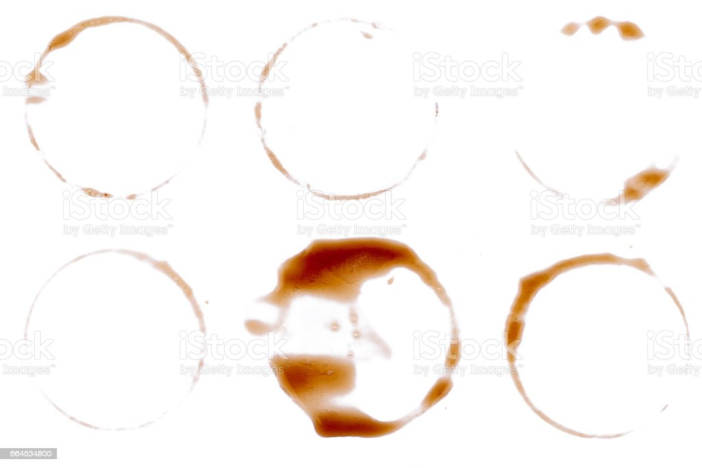 Six coffee mug stain rings on paper, isolated on white backgroun stock photo