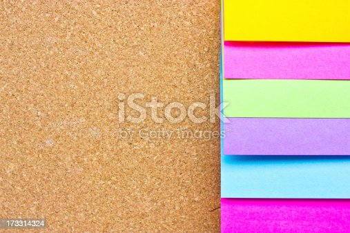 istock Six colorful sticky notes on wooden board. 173314324