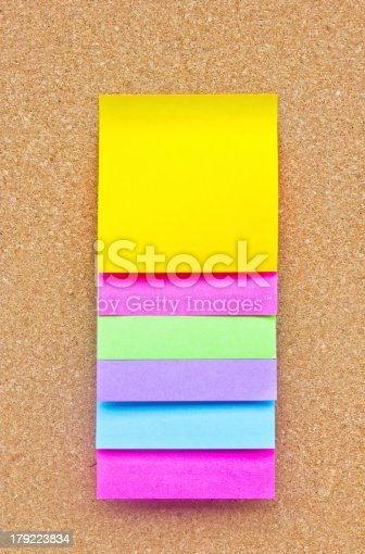 istock Six colorful sticky notes on wooden board. 179223834