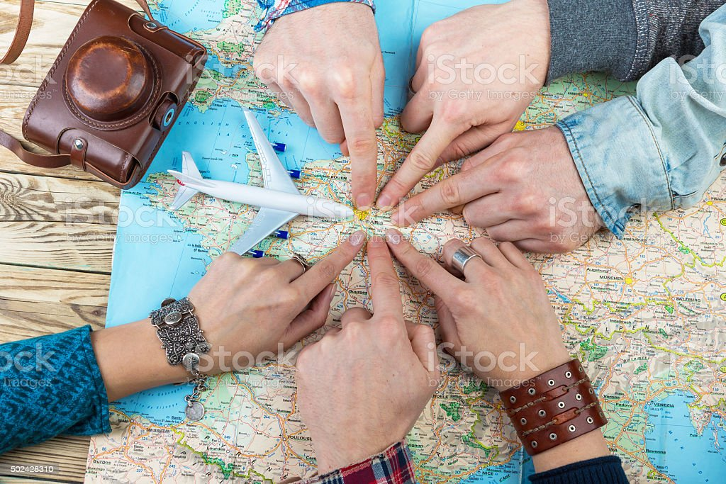 six cool friends are planning euro trip. stock photo