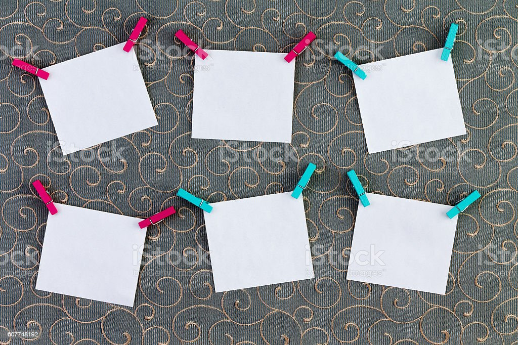 Six crooked tags attached to clothespins stock photo