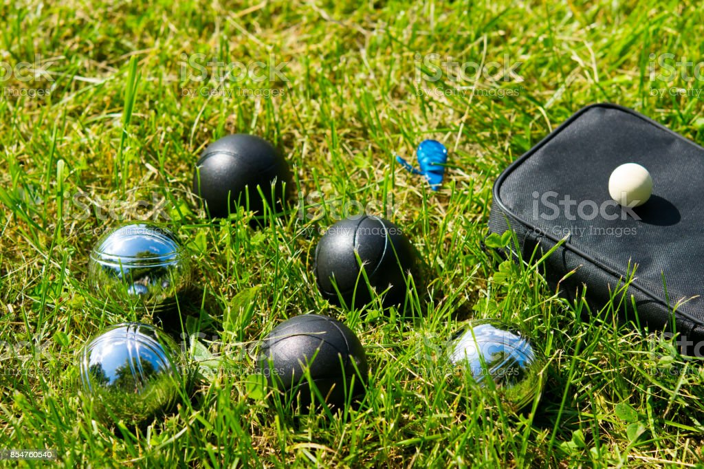 Six different balls for playing bocce on the lawn stock photo
