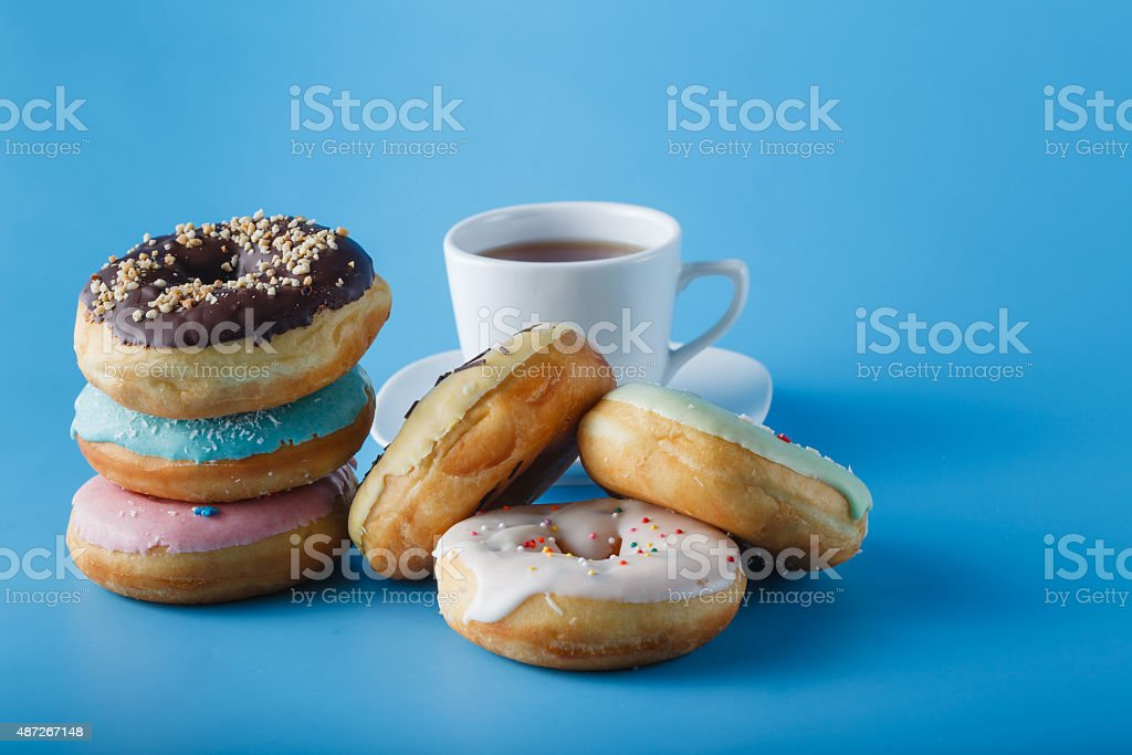 Six donuts on blue shadeless background stock photo