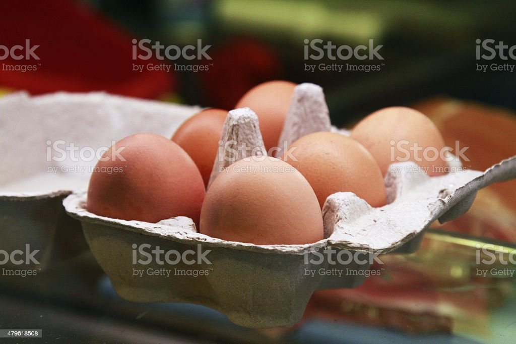 six eggs in a box stock photo