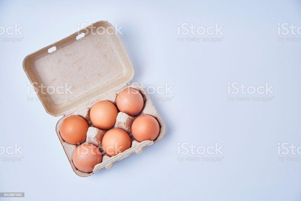 Six eggs in paper box stock photo