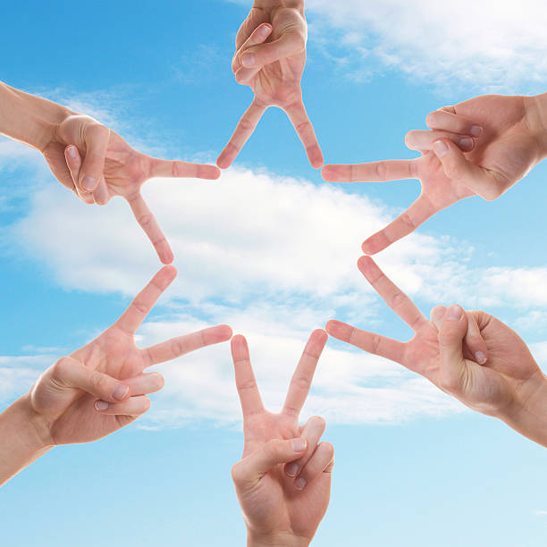 six hands making a star in the sky with their fingers - cursed stock pictures, royalty-free photos & images