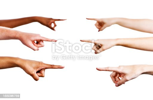 Six mixed hands point across frame at each other, indicating, accusing or blaming. Isolated on white.