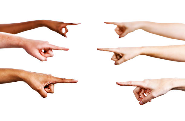 Six hands pointing: accusing, blaming or simply indicating someone stock photo