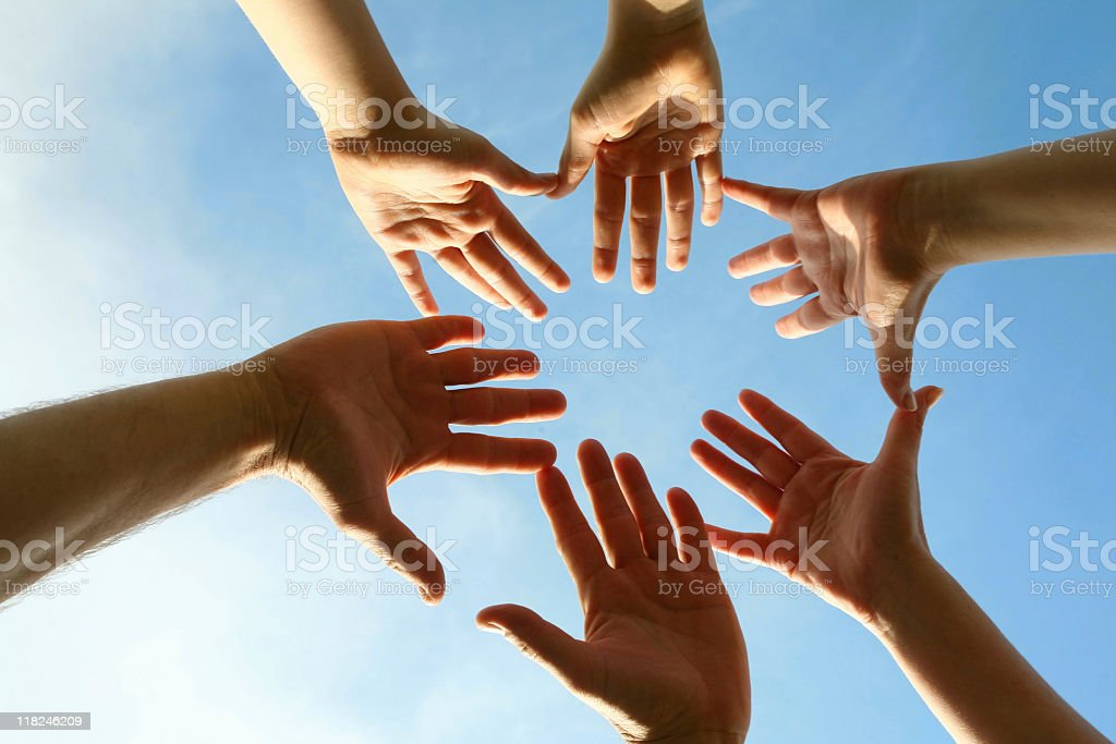 Six hands reaching towards each other royalty-free stock photo