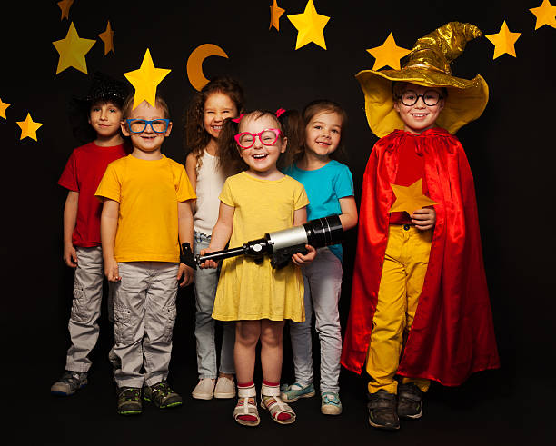 six kids in stargazers costumes with telescope - performing arts event stock pictures, royalty-free photos & images