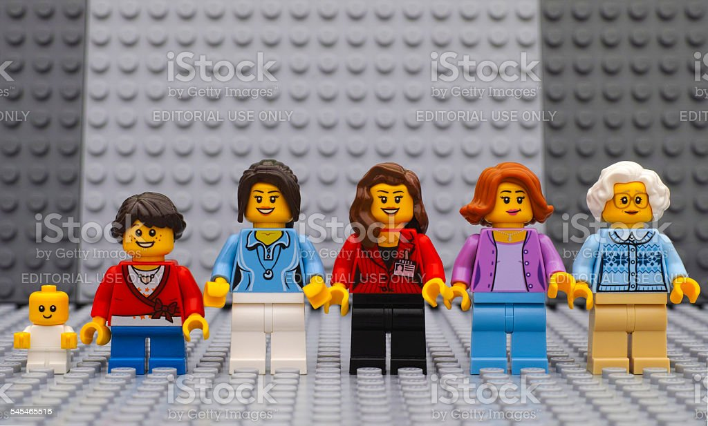 Six Lego woman minifigures of different age stock photo