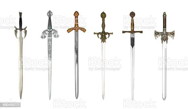 Six beautiful medieval swords isolated on white