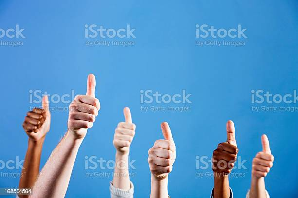 Six Mixed Hands Give Thumbs Up Of Approval And Endorsement Stock Photo - Download Image Now