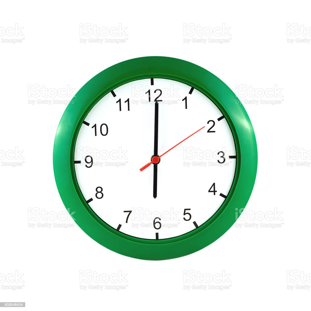 Six o'clock  on green wall clock stock photo