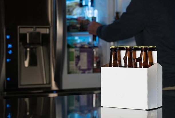 six pack of brown beer bottles on kitchen counter - pack de six photos et images de collection