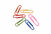 Six paper clips on a white background