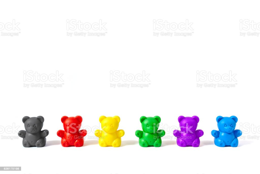 Six plastic bear figures in the colors of Germany's major political parties, isolated on white background stock photo