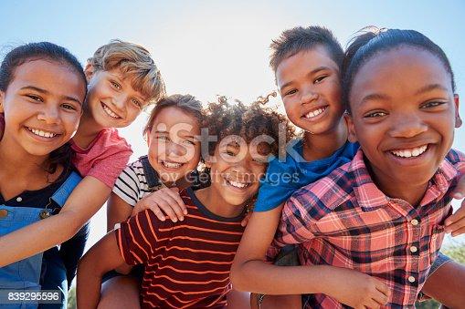 istock Six pre-teen friends piggybacking in a park, close up portrait 839295596