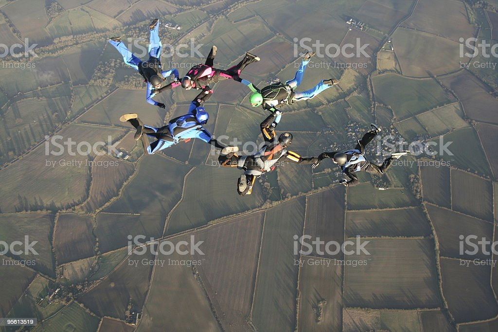 Six skydivers in freefall royalty-free stock photo