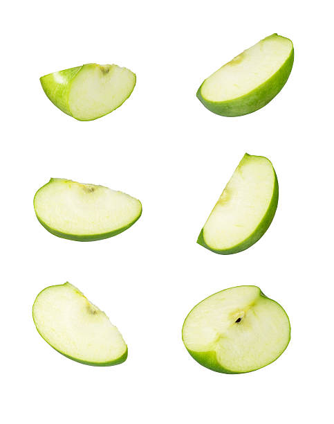 Six sliced pieces of green apple stock photo