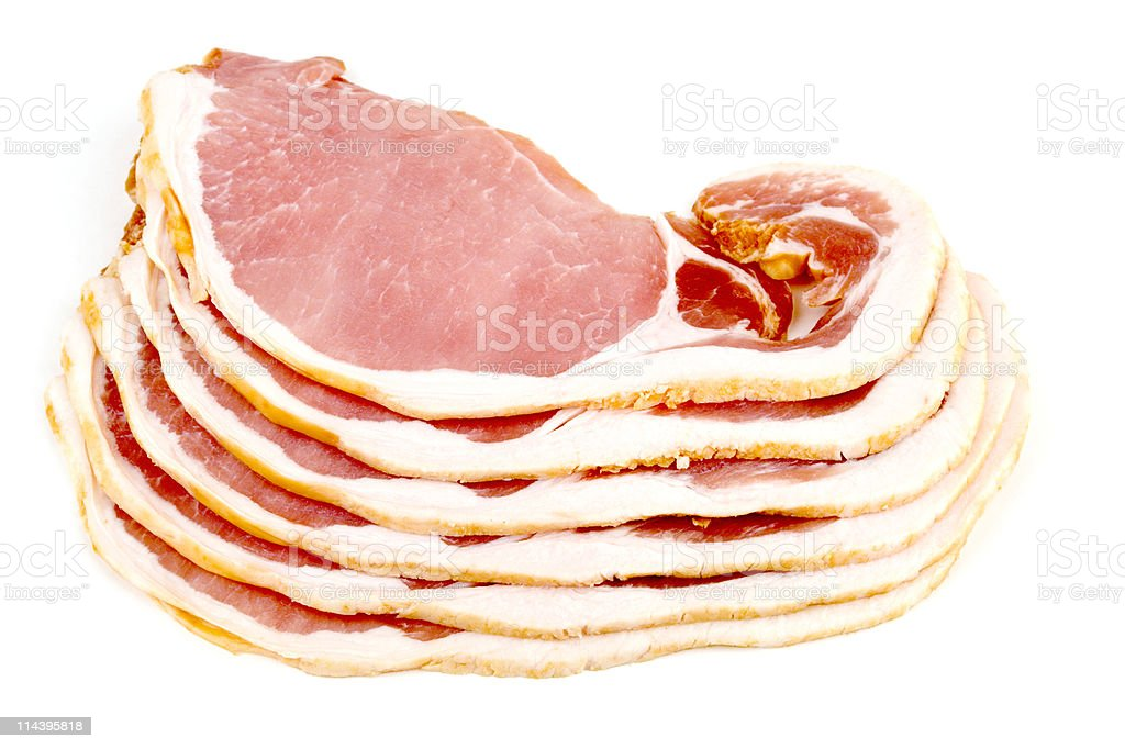 Six slices of vertically stacked bacon on white background royalty-free stock photo